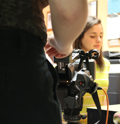 Student working on a camera